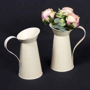 Vintage cream jugs with flowers for Weddings